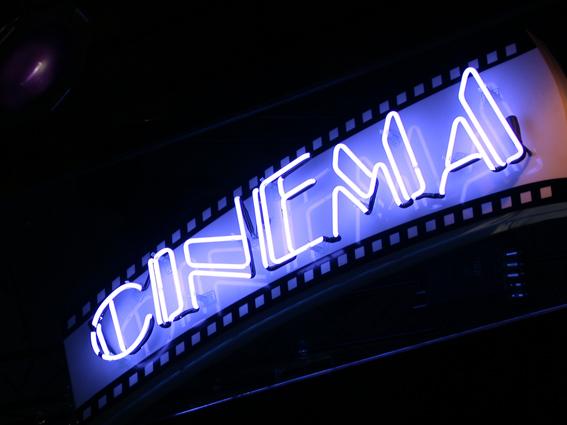 bigstockphoto_blue_neon_cinema_sign_2448262
